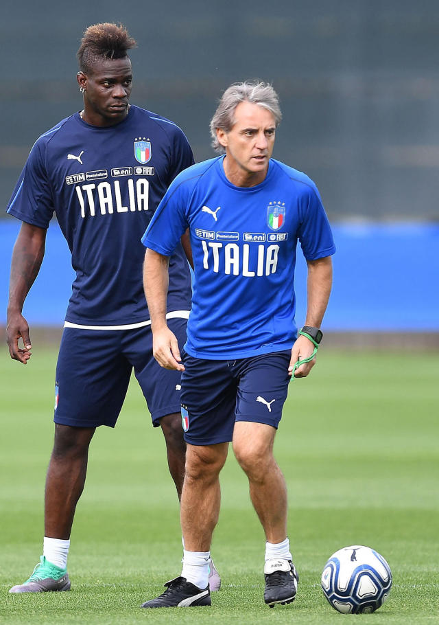 Italy's head coach, Roberto Mancini, is flanked by Mario Balotelli during a training session at the Juventus' sport center in Vinovo, near Turin, Italy, Saturday, June 2, 2018. Italy will play the Netherlands in a friendly match in Turin Monday. (Alessandro Di Marco/ANSA via AP)