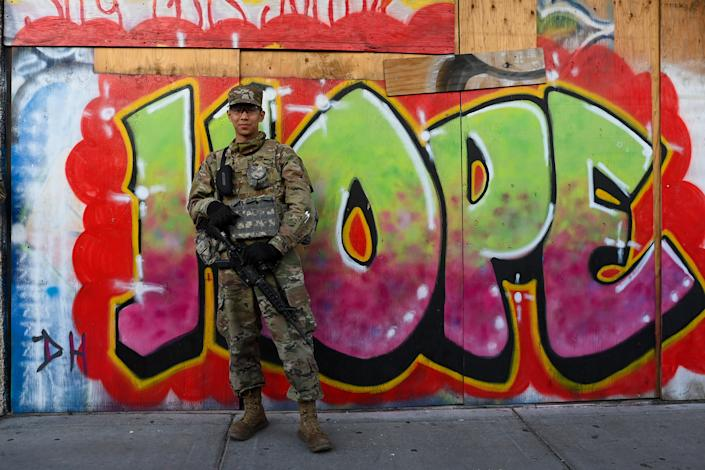 MINNEAPOLIS, MN - APRIL16: A member of the National Guard patrols along Hennepin Avenue on April 16, 2021 in Minneapolis, Minnesota. National Guard soldiers are seen across Minneapolis as the city prepares for reaction to the verdict on the Derek Chain trial. The trial of former Minneapolis police officer Derek Chauvin, who faces multiple charges in the death of George Floyd after kneeling on Floyd's neck for more than eight minutes during an arrest last May. Closing arguments begin Monday (Photo by Joshua Lott/The Washington Post via Getty Images)
