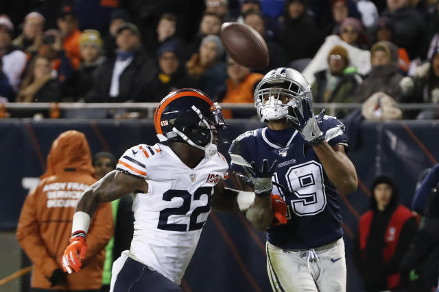 Dallas Cowboys' Amari Cooper (19) makes a touchdown reception against Chicago Bears' Kevin Toliver (22) during the second half of an NFL football game, Thursday, Dec. 5, 2019, in Chicago. (AP Photo/Charles Rex Arbogast)