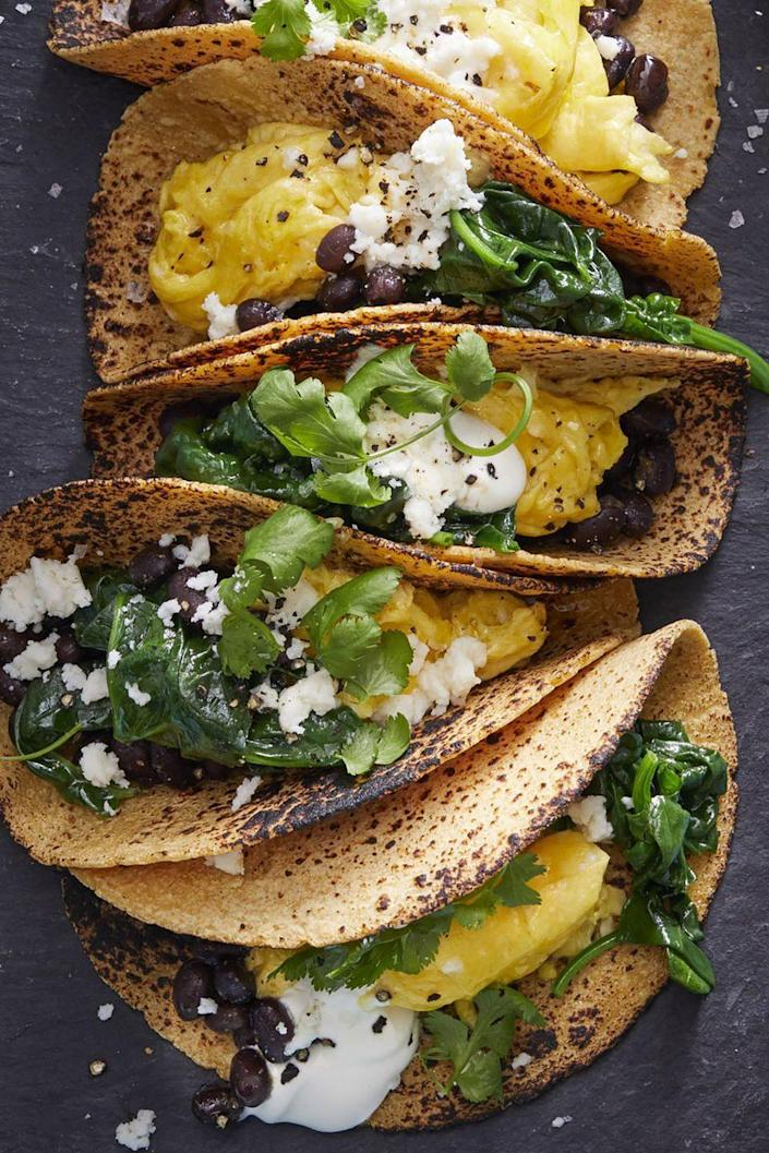 "<p>For a more savory breakfast, these breakfast tacos made with spinach, black beans, and scrambled eggs are a filling option. </p><p><strong><a href=""https://www.womansday.com/food-recipes/food-drinks/a16764124/scrambled-egg-tacos-recipe/"" rel=""nofollow noopener"" target=""_blank"" data-ylk=""slk:Get the Scrambled Egg Tacos recipe."" class=""link rapid-noclick-resp""><em>Get the Scrambled Egg Tacos recipe.</em></a></strong></p>"