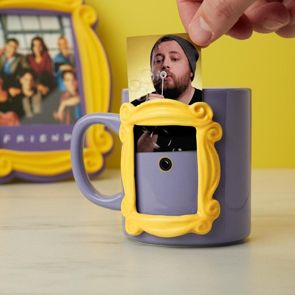 <p>Put a smile on a friend's face with this <span><b>Friends</b> Photo Frame Mug</span> ($18). </p>