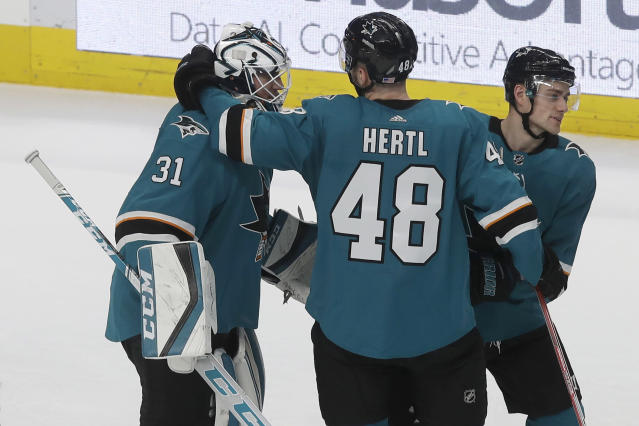 San Jose Sharks goaltender Martin Jones (31) celebrates with Tomas Hertl (48) and Dylan Gambrell after the Sharks defeated the Nashville Predators in an NHL hockey game in San Jose, Calif., Saturday, Nov. 9, 2019. The Sharks won 2-1 in a shootout. (AP Photo/Jeff Chiu)