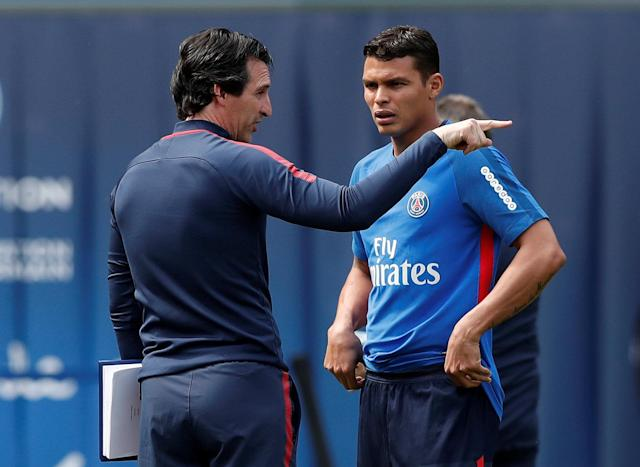 REFILE - CORRECTING PLACE Soccer Football - Ligue 1 - Paris St Germain Training - Parc des Princes, Paris, France - May 16, 2018 Paris Saint-Germain coach Unai Emery and Thiago Silva during training REUTERS/Benoit Tessier