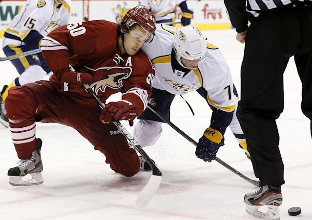 Phoenix Coyotes' Antoine Vermette (50) and Nashville Predators' Matt Cullen battle for the puck after a face off during the first period of an NHL hockey game on Thursday, Oct. 31, 2013, in Glendale, Ariz. (AP Photo/Ross D. Franklin)