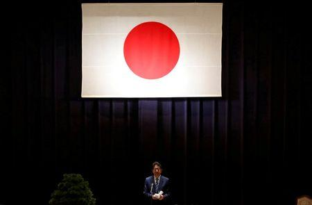 Japan's PM Abe address Japan Self-Defense Force's senior members during a meeting at the Defense Ministry in Tokyo
