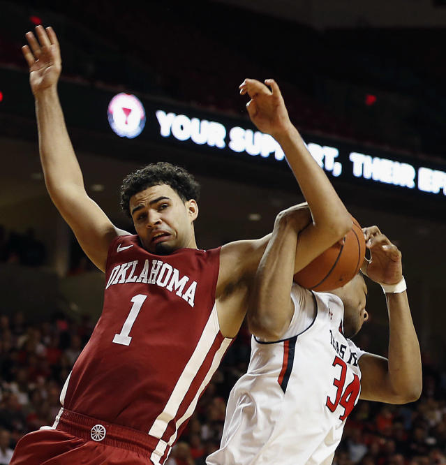 Texas Tech's Alex Foster, right, and Oklahoma's Frank Booker battle for a rebound during an NCAA college basketball game in Lubbock, Texas, Saturday, Jan. 25, 2014. (AP Photo/The Avalanche-Journal, Tori Eichberger)
