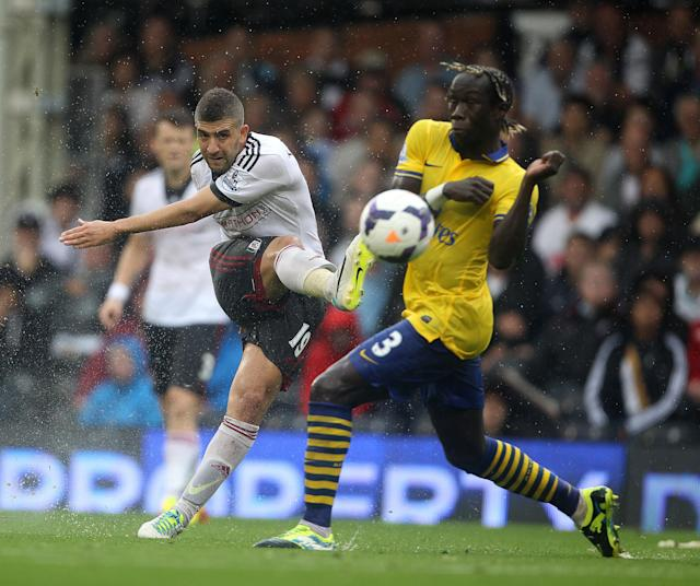 Arsenal's Bacary Sagna tries to block a shot by Fulham's Adel Taarabt during the Barclays Premier League match at Craven Cottage, London.