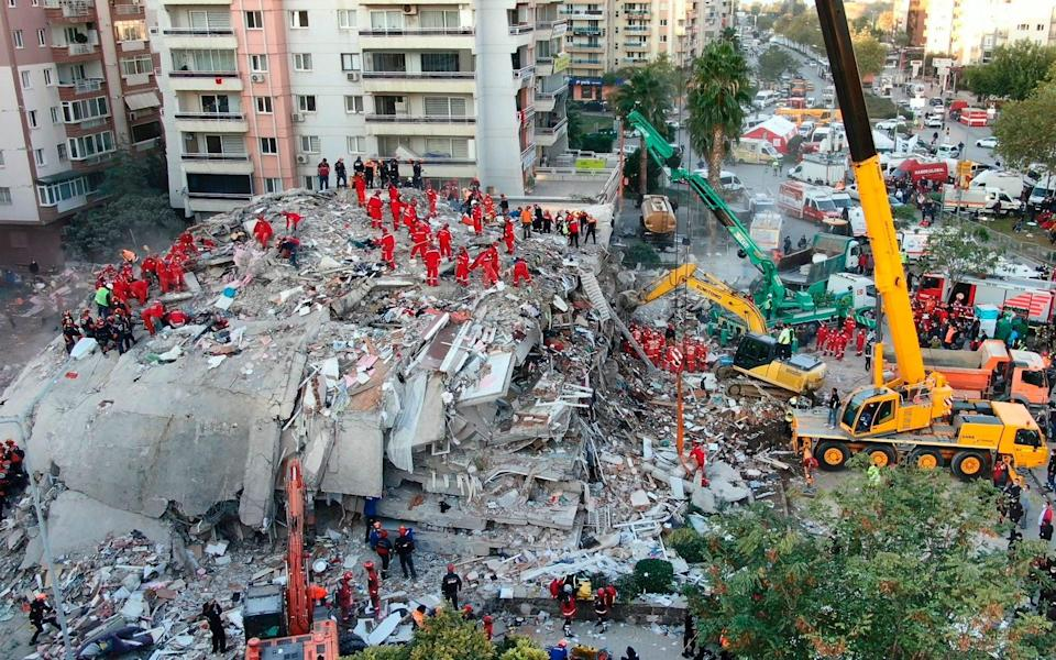 Rescue services search for survivors in the debris of collapsed buildings in Izmir, Turkey - IHA