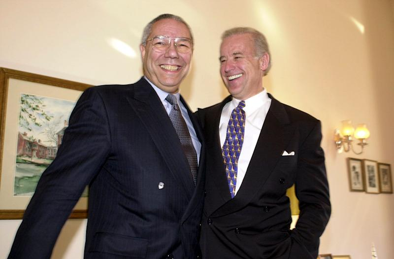 Gen. Colin Powell and Biden share a light moment during a photo op before a question-and-answer session with the press on Jan. 9, 2001.