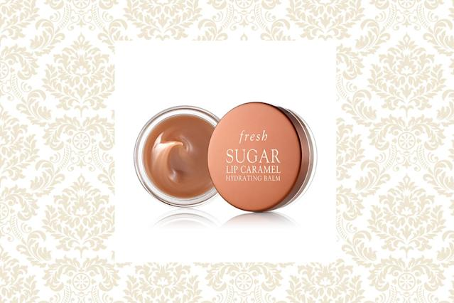 "<p>If you like caramel, you will find this supercharged balm delightful. With its rich mix of emollients such as grapeseed and apricot kernel oils, you are in for a treat every time you smooth on this beautiful balm. $18, <a href=""http://www.fresh.com/US/lip-balms/sugar-lip-caramel-hydrating-balm/H00004209.html?gclid=EAIaIQobChMI073_x-_c2AIVhYWzCh2HQAFzEAQYAiABEgIJ4PD_BwE"" rel=""nofollow noopener"" target=""_blank"" data-ylk=""slk:fresh.com"" class=""link rapid-noclick-resp"">fresh.com</a> (Photo: Fresh/Getty) </p>"