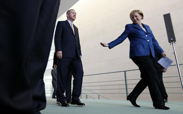 <p>Turkey's Prime Minister Tayyip Erdogan (L) and German Chancellor Angela Merkel arrive to address a news conference following their bilateral talks in Berlin October 9, 2010. (Fabrizio Bensch/Reuters) </p>