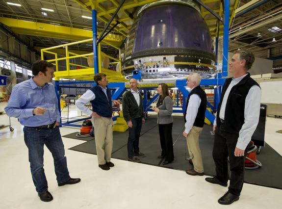 NASA Deputy Administrator Lori Garver, fourth from left, meets Blue Origin founder Jeff Bezos in December 2011, shown next to Blue Origin's crew capsule. Other Blue Origin team members are Bretton Alexander, left; Jeff Ashby, second from left R