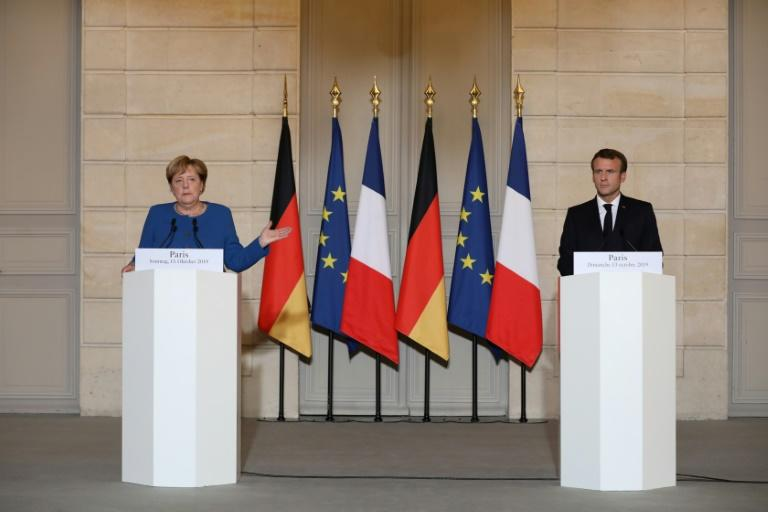 French President Emmanuel Macron (L) and German Chancellor Angela Merkel call for an end to the Turkish offensive in Syria (AFP Photo/ludovic MARIN)