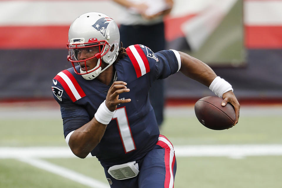 FILE - In this Sunday, Sept. 27, 2020, file photo, New England Patriots quarterback Cam Newton runs against the Las Vegas Raiders during an NFL football game at Gillette Stadium, in Foxborough, Mass. For the second straight week the New England Patriots are heading into a game after having their preparations disrupted by a teammate contracting coronavirus.  Last week it was Cam Newton, who tested positive two days before their matchup with Kansas City and was forced to sit out.(AP Photo/Winslow Townson, File)