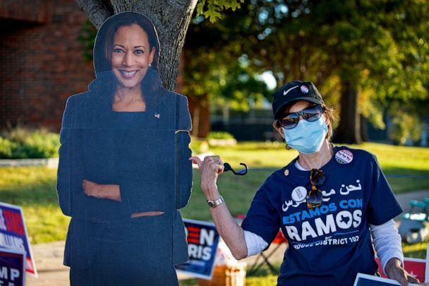 PHOTO: A person waits in line to vote near a large depicting Vice Presidential candidate Kamala Harris, outside Fretz Park Branch Dallas Public Library, on Oct. 29, 2020 in Dallas.  (Montinique Monroe/Getty Images, FILE)