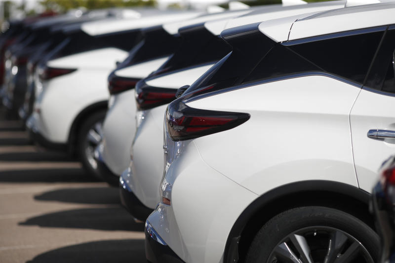 In this Aug. 25, 2019, photo unsold Murano sports-utility vehicles sit at a Nissan dealership in Highlands Ranch, Colo. On Wednesday, Oct. 16, the Commerce Department releases U.S. retail sales data for September. (AP Photo/David Zalubowski)
