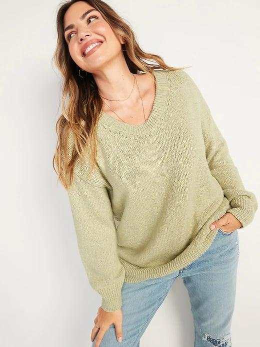 <p>It may be not quite a v-neck and not quite a scoop, but we're still loving this <span>Old Navy Oversized Voop-Neck Tunic Sweater</span> ($35) in green, pink, or black.</p>