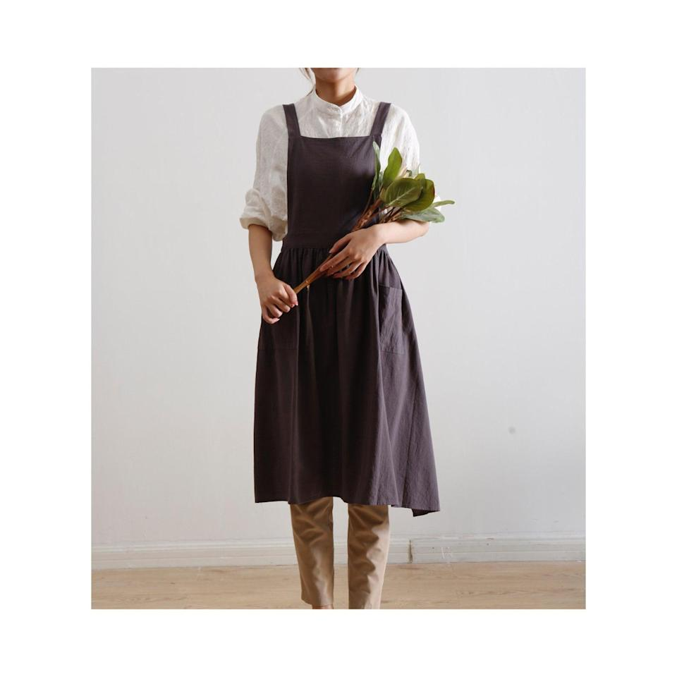 """<h2>Stacy Kitchen Decor Linen Pinafore Apron<br></h2><br>Personal endorsement: I am a mom and an avid apron-wearer. Whether I'm in the line of fire during dinner with my toddler, baking, painting, re-potting plants, spackling, whatever — I love that I can just throw this on and not worry about destroying whatever I'm wearing. This beautifully tailored pinafore apron is pretty enough for prime time and rendered in a cool & easy cotton-linen blend that I wouldn't be afraid of getting dirty.<br><br><em>Shop <strong><a href=""""https://www.etsy.com/shop/StacyKitchenDecor"""" rel=""""nofollow noopener"""" target=""""_blank"""" data-ylk=""""slk:Stacy Kitchen Decor"""" class=""""link rapid-noclick-resp"""">Stacy Kitchen Decor</a></strong> on Etsy</em><br><br><strong>Stacy Kitchen Decor</strong> Linen Pinafore Apron, $, available at <a href=""""https://go.skimresources.com/?id=30283X879131&url=https%3A%2F%2Fwww.etsy.com%2Flisting%2F817025749%2Fpinafore-apron-apron-for-women-charcoal"""" rel=""""nofollow noopener"""" target=""""_blank"""" data-ylk=""""slk:Etsy"""" class=""""link rapid-noclick-resp"""">Etsy</a>"""