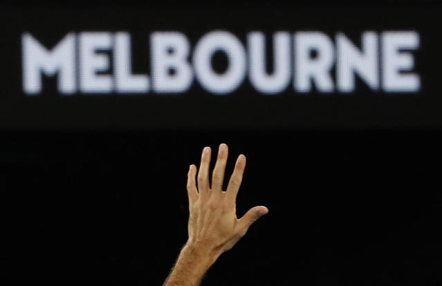 Tennis - Australian Open - Fourth Round - Melbourne Park, Melbourne, Australia, January 20, 2019. Switzerland's Roger Federer gestures as he leaves the court after losing the match against Greece's Stefanos Tsitsipas. REUTERS/Adnan Abidi