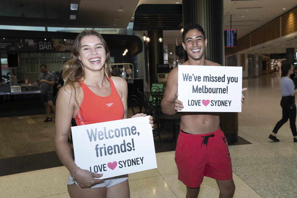 New South Wales reopened its border to Victoria at 12:01 on Monday 23 November, and it was a party in the terminal. Source: Getty