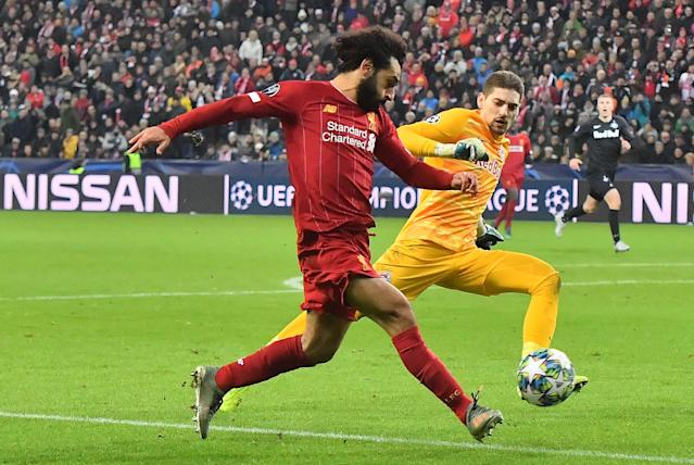 Mo Salah sealed the victory with a delightful finish. (Photo by JOE KLAMAR / AFP)