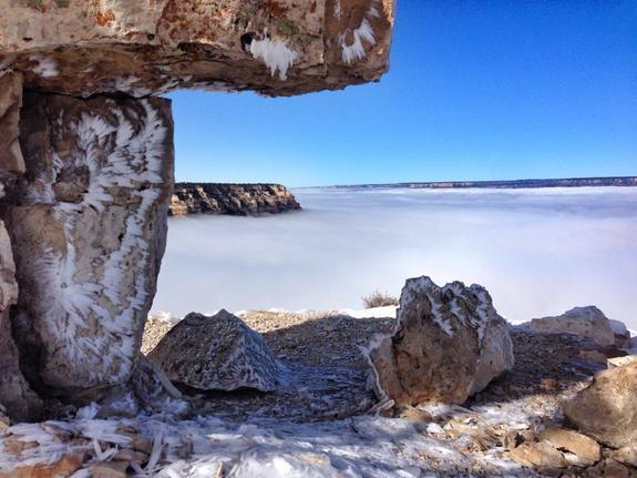 Fog filling the Grand Canyon. Noticed the ice crystals on the limestone in the foreground.
