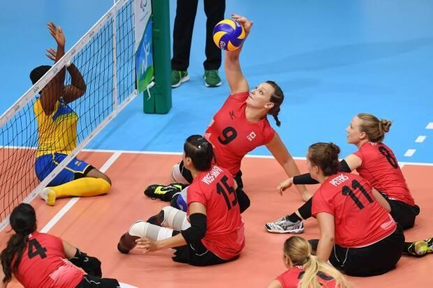 Canada's Danielle Ellis spikes the ball during a sitting volleyball game at the Rio 2016 Paralympics. CBC Sports has expanded coverage plans to include live streams of Canada's first two women's sitting volleyball matches from the Tokyo 2020 Paralympics. (Atsushi Tomura/Getty Images - image credit)