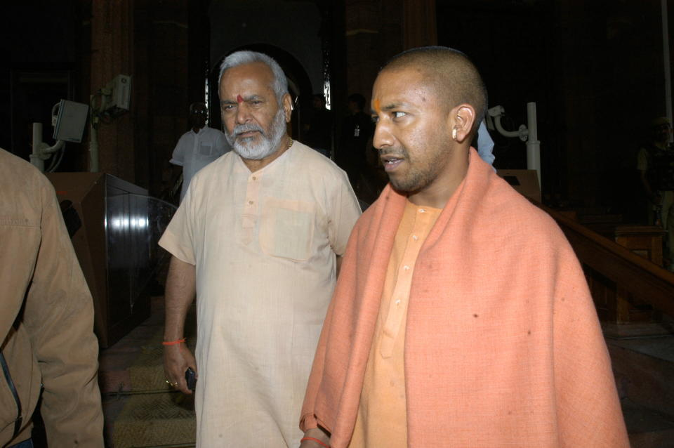 INDIA - MARCH 12:  Yogi Adityanath, BJP Member of Parliament from Gorakhpur, Uttar Pradesh and BJP leader Swami Chinmayanand at Parliament House in New Delhi, India (Parliament Session Feb-March 2007)  (Photo by Sipra Das/The The India Today Group via Getty Images)