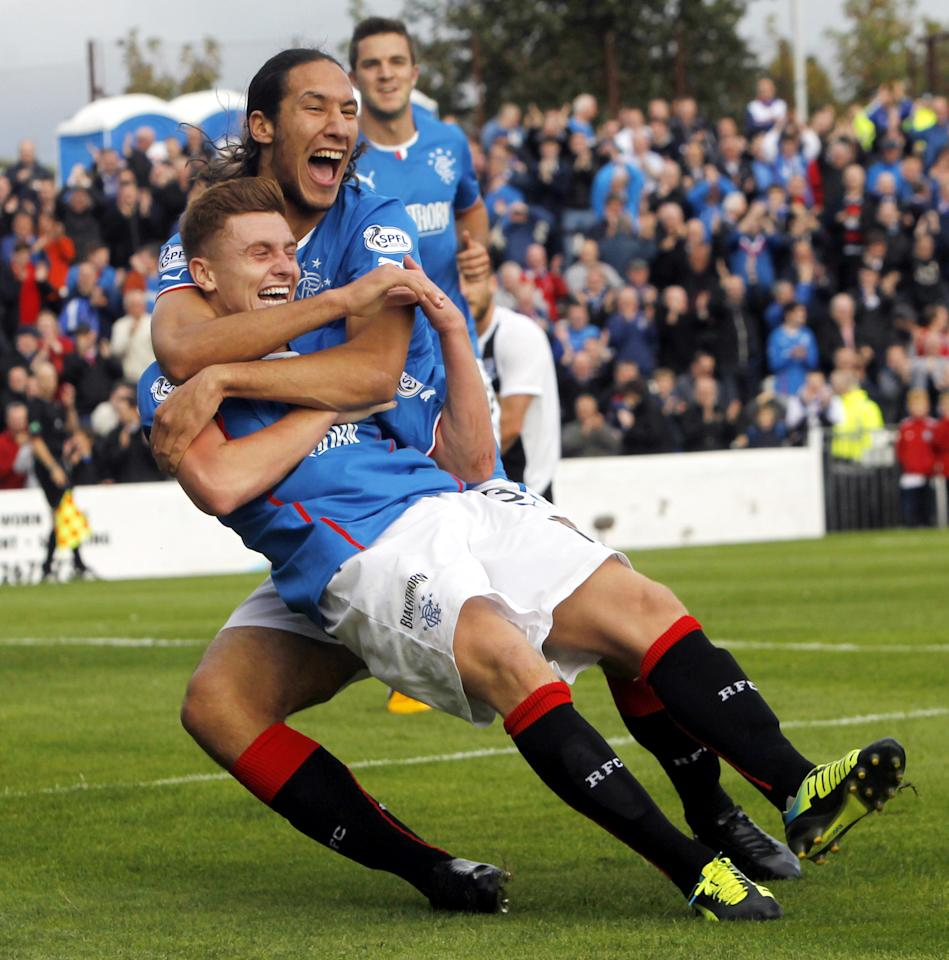 Rangers' Lewis McLeod celebrates his goal with team-mate Belil Mohsni during the Scottish League One match at Somerset Park, Ayr.