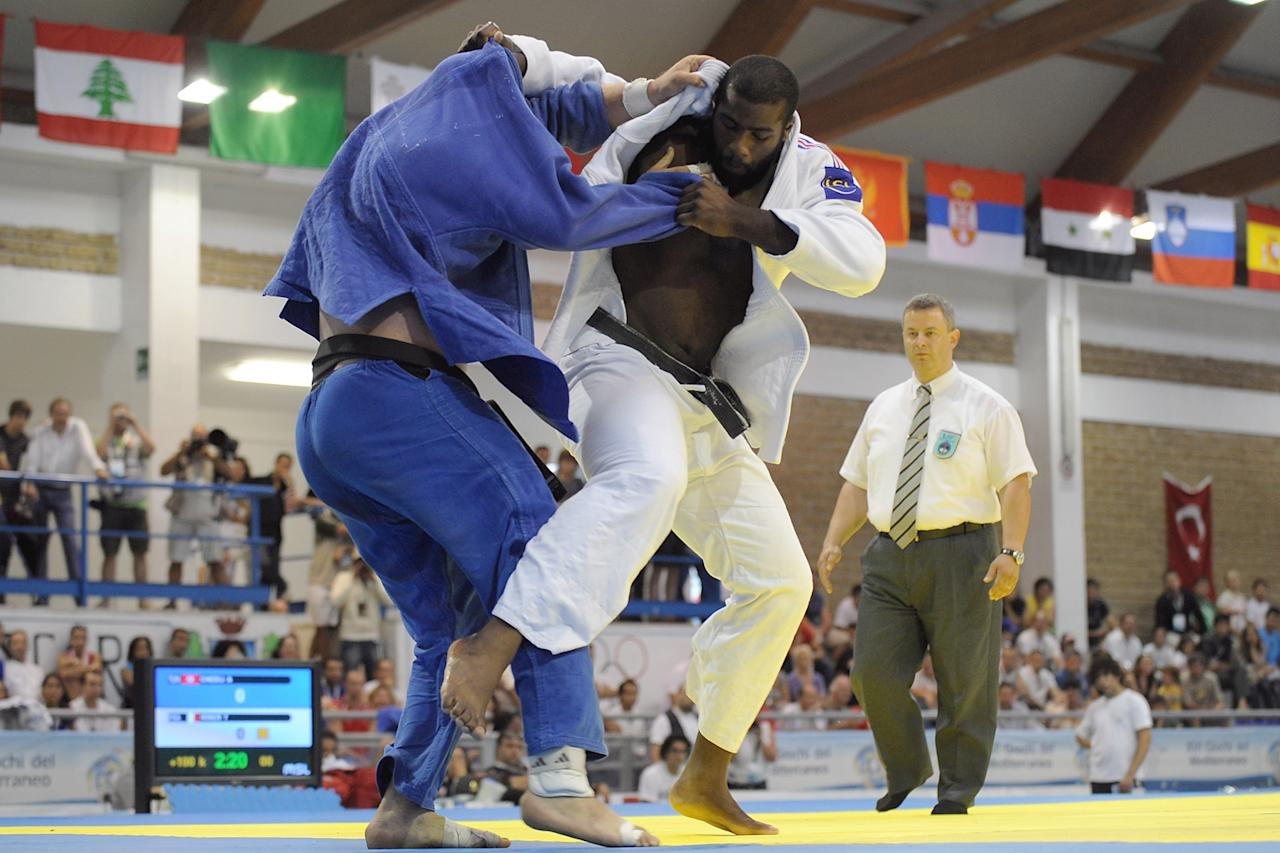 Teddy Riner (R) of France and Anis Chedli of Tunisia compete in the men's  100 Kg Judo final event of the XVI Mediterranean Games at Febo Complex on July 5, 2009 in Pescara, Italy