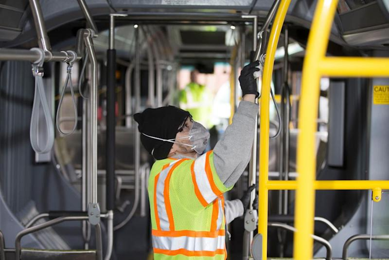 A worker cleans a bus in response to the Seattle-area novel coronavirus outbreak in Seattle.