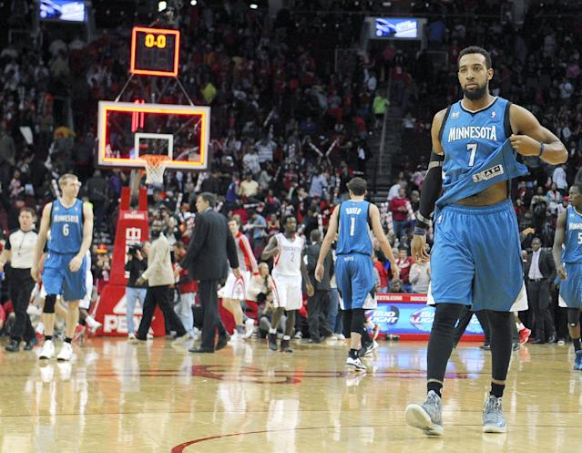 Minnesota Timberwolves' Derrick Williams (7) walks off the court at the end of an NBA basketball game against the Houston Rockets Saturday, Nov. 23, 2013, in Houston. The Rockets won 112-101. (AP Photo/Pat Sullivan)