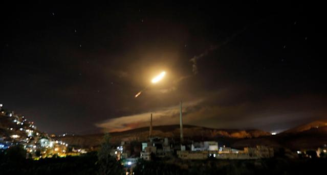 <p>Syrian air defense missiles are seen in the sky over the capital Damascus, Syria, 10 May 2018. According to Syrian official media reports, the air defense was responding to a new wave of Israeli missile strikes. (Photo: Youssef Badawi/EPA-EFE/REX/Shutterstock) </p>