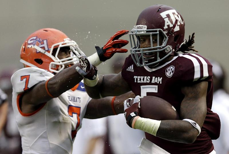 Texas A&M running back Brandon Williams (5) is tackled by Sam Houston State safety Johntel Franklin (7) during the second quarter of an NCAA college football game Saturday, Sept. 7, 2013, in College Station, Texas. (AP Photo/David J. Phillip)