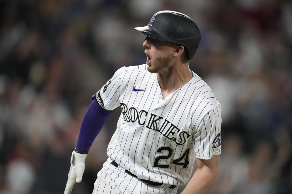 Colorado Rockies' Ryan McMahon turns to the dugout and yells as he heads up the first-base line after hitting a two-run home run off San Diego Padres starting pitcher Yu Darvish during the sixth inning of a baseball game Tuesday, June 15, 2021, in Denver. (AP Photo/David Zalubowski)