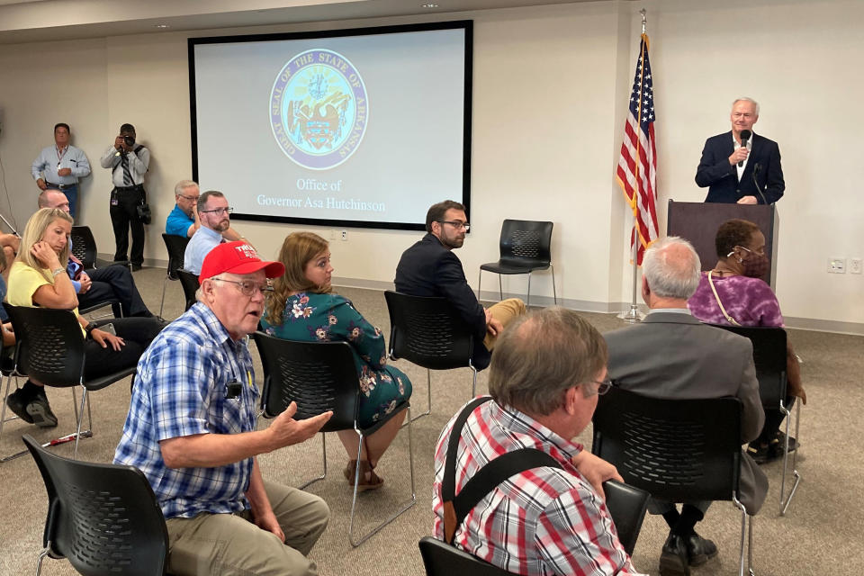 Robert Hogan speaks at the Batesville Community Center in Batesville, Ark., on Monday, July 12, 2021 as Arkansas Gov. Asa Hutchinson looks on. Hutchinson has been holding a series of town hall meetings aimed at encouraging coronavirus vaccinations in the state. (AP Photo/Andrew DeMillo)