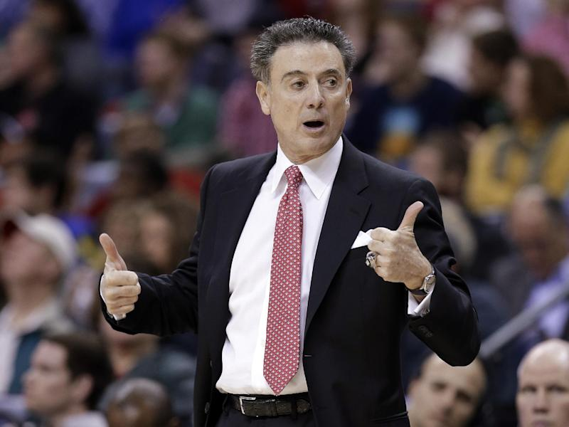 Louisville coach Rick Pitino calls for a jump ball during the first half of an NCAA college basketball game against Connecticut in the finals of the American Athletic Conference men's tournament Saturday, March 15, 2014, in Memphis, Tenn. (AP Photo/Mark Humphrey)