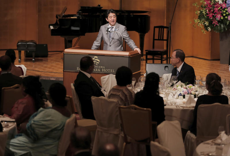 Japanese Prime Minister Shinzo Abe delivers a speech as U.N. Secretary-General Ban Ki-moon, second from right, listens during the official dinner hosted by Abe at the Tokyo International Conference on African Development (TICAD) in Yokohama, near Tokyo, Sunday, June 2, 2013. Japan announced Sunday a plan to provide 100 billion yen ($1 billion) in aid over the next five years to northern Africa for economic development and humanitarian efforts, including help with security and counter-terrorism measures. (AP Photo/Itsuo Inouye)