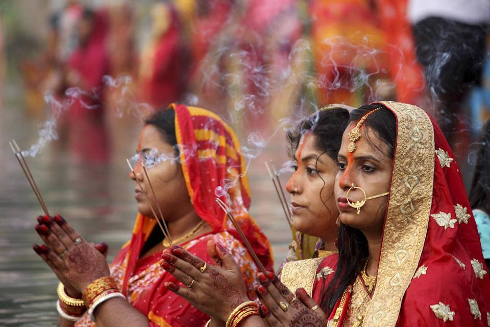 Devotees pray to the Sun God in a pond on the occasion of Chhath Puja, in Agartala, Friday, 20 November.