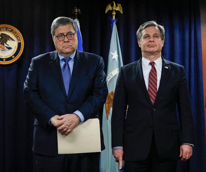 Attorney General William Barr and FBI Director Christopher Wray say the man who killed three people in a shooting at a Florida naval base was in near-constant contact with al-Qaida.