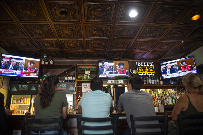 People watch former special counsel Robert Mueller testify before Congress at Duffys Irish Pub in Washington, D.C., on Wednesday. (Photo by Caroline Brehman/CQ Roll Call)