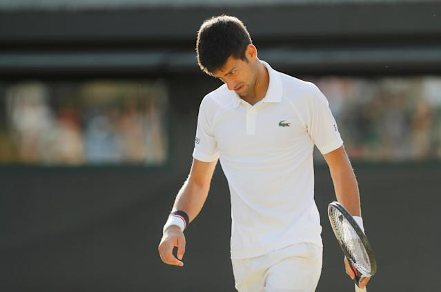 FILE PHOTO: Tennis – Wimbledon – London, Britain – July 12, 2017 Serbia's Novak Djokovic reacts as he retires from his quarter final match against the Czech Republic's Tomas Berdych with an injury REUTERS/Matthew Childs/File Photo