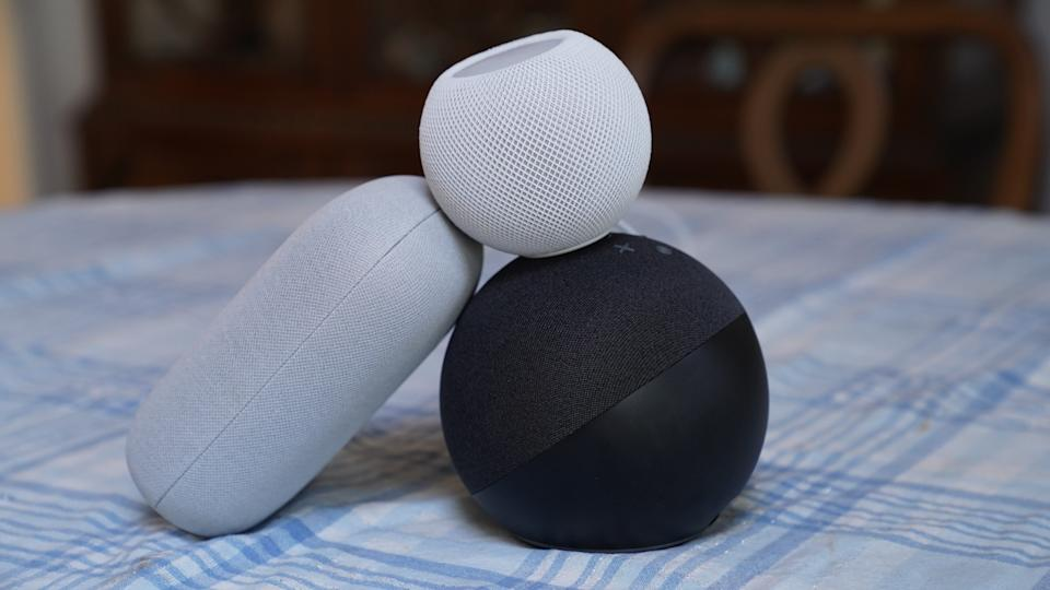 Google Nest Audio, left, Amazon Echo, bottom, Apple's HomePod Mini on top.