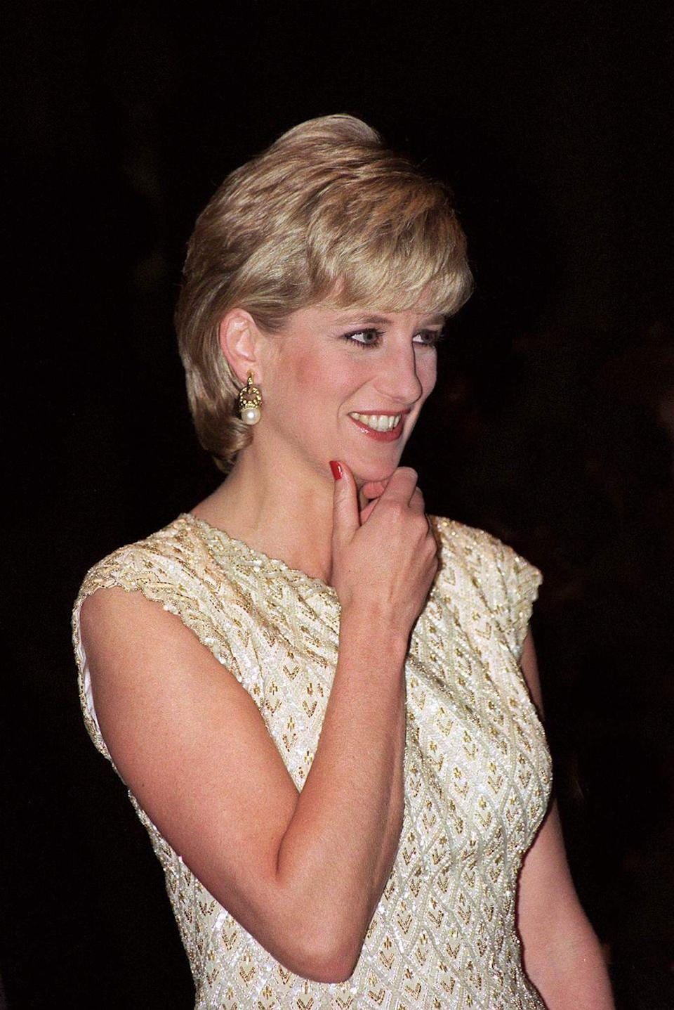 """<p>Princess Diana chose to accessorize simply with a pair of gold and pearl earrings for a 1996 ballet performance of """"Alice in Wonderland.""""<br></p><p><strong>More</strong>: <a href=""""https://www.townandcountrymag.com/society/tradition/g25919230/royal-family-ballet-photos/"""" rel=""""nofollow noopener"""" target=""""_blank"""" data-ylk=""""slk:Royals at the Ballet"""" class=""""link rapid-noclick-resp"""">Royals at the Ballet</a> </p>"""