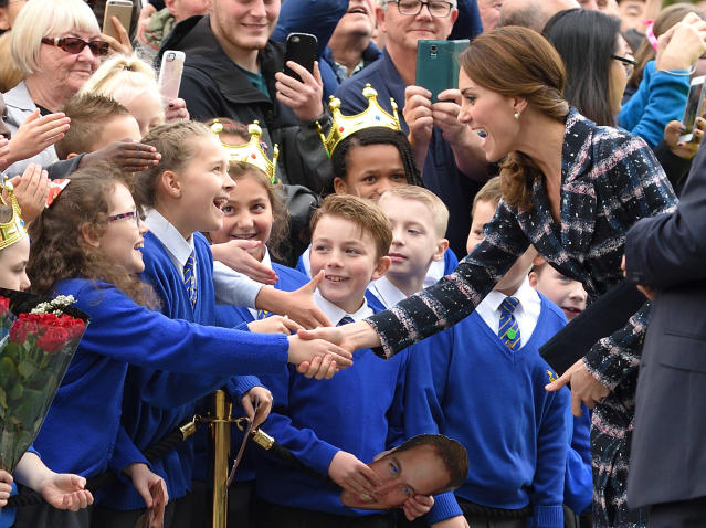<p>Catherine, Duchess of Cambridge, greets excited school children as she leaves a reception at the National Football Museum on Oct. 14, 2016 in Manchester, England. (Photo by Karwai Tang/WireImage) </p>