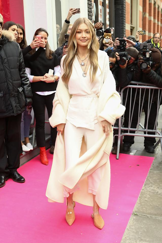 """<p>While promoting her new <a rel=""""nofollow"""" href=""""https://www.stuartweitzman.com/products/eyelove/deep-indigo-suede/?cvo_campaign=&utm_campaign=&utm_source=google&utm_medium=cpc&utm_term=stuart%20weitzman%20gigi%20hadid&cvosrc=ppc.google.Stuart%20weitzman%20gigi%20hadid&matchtype=e&cvo_crid=232820759435&gclid=Cj0KCQiAus_QBRDgARIsAIRGNGiwgnT1vo2qFAj5kB7CO22GFtBnDRmvrLVXUrFQLvQ8O-0ZaPooGTEaAuyMEALw_wcB&ef_id=WbGH2gAAAIMg2kX5:20171121160148:s"""">shoe collection with Suart Weitzman</a>, Gigi walked the red carpet in an all-white ensemble tied together with what's basically a fluffy robe. I'm living for this level of comfy. </p>"""