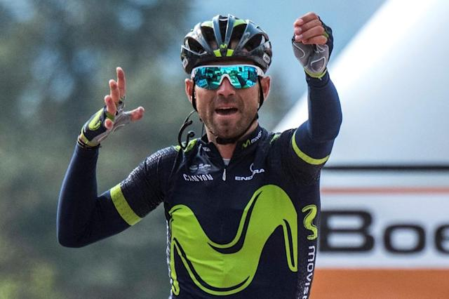 Alejandro Valverde of the Movistar team celebrates as he crosses the finish line in Mur de Huy during the Fleche Wallonne cycling race on April 19, 2017 going from Binche to Mur de Huy (AFP Photo/PHILIPPE LOPEZ)