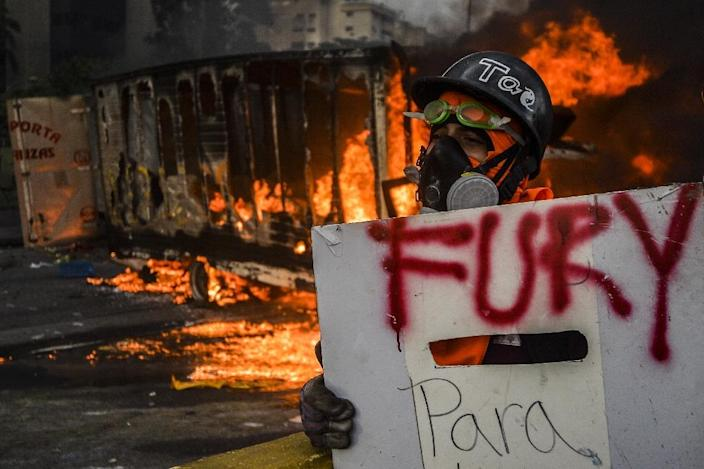 More than 70 people have been killed since the start of opposition protests against Venezuelan President Nicolas Maduro on April 1 (AFP Photo/LUIS ROBAYO)