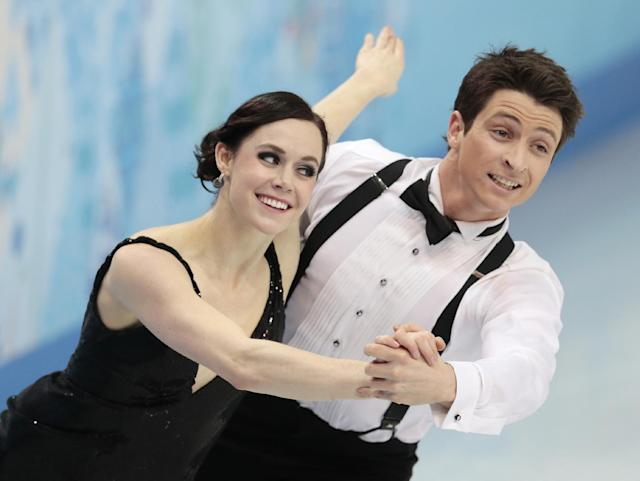 Tessa Virtue and Scott Moir of Canada compete in the team ice dance short dance figure skating competition at the Iceberg Skating Palace during the 2014 Winter Olympics, Saturday, Feb. 8, 2014, in Sochi, Russia. (AP Photo/Ivan Sekretarev)