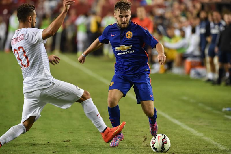 Manchester United's Luke Shaw (R) vies with Inter Milan's Danilo D'Ambrosio during a Champions Cup match at FedEx Field in Landover, Maryland, on July 29, 2014